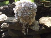 14 inch Ivory Brooch Bouquet. Gorgeous cascading jeweled bouquet embellished with Swarovski crystals