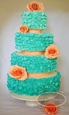See those turquoise ruffles?  They're indivudually cut flower petals that were ruffled and placed on each tier.  Wowzer.  By SugablossomCakes on CakeCentral.com
