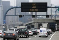 """Changing Lanes? Use Yah Blinkah."". Electronic Hwy signs throughout Boston."