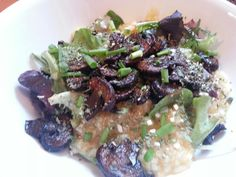 Lunch: Congee With Spring Mix And Roasted Mushrooms And herbs  #vegan