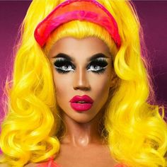I absolutely adore Naomi Smalls from RuPaul's Drag Race. All of her looks screamed creativity. This so happens to be one of my favorite looks she accomplished during the season. She painted her face flawlessly. The pink and yellow are a color match made in heaven.