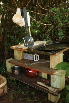 Outdoor Play Kitchen :)  a branch would make a lovely addition for utensil storage in our sandpit or dirt pit kitchens.