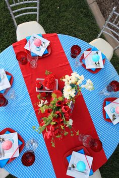 Not these colors, but the idea of the bold tablecloth, plus a table runner with bold color. Needs more candles, though -- Superman colors! Primary color wedding theme // photo love stories