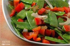 Fast and fresh side dish snow peas with red bell pepper, garlic and shallots