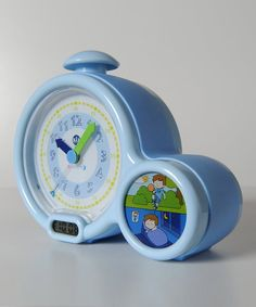 Kid'Sleep My First Alarm Clock. Give kids independence by having their own alarm clock that shows time in both digital & analog. 4 alarm sounds of chirping birds, a cuckoo or a train grow progressively louder until a sleepy sweetie turns it off or hits snooze button. When the sleeping child on the Kid'Sleep feature is lit, they know to stay in bed longer. A mini night-light emits a reassuring glow $29.99 [Video] https://www.youtube.com/watch?feature=player_embedded&v=RFAFD9h8HLI