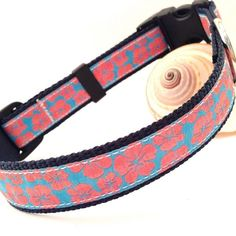 Pink Hibiscus Dog Collar with saltwater proof stainless steel D-ring, marine webbing,UV resistant thread and premium plastics.  Available in small, medium, and large with matching leash.