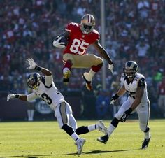 The best photo taken at Candlestick this year: Vernon Davis goes high over two defenders with a big catch in the first half against the St. Louis Rams on Dec. 1, 2013. #49ers #FarewellCandlestick