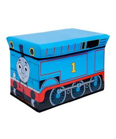 All aboard! Tuck away toys, clutter and little trinkets in this lively Thomas the Train-inspired storage ottoman. Perfect for that cutie conductor's playroom, this brightly colored bin keeps rooms clean and organized.