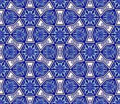 Seamless blue on white pattern inspired by Islamic art.