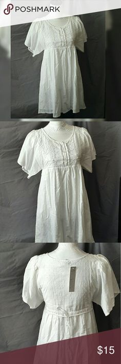 BNWT Woman's Small White Eyelet Dress...by Pinky Brand new with tags.  Very cute, white, flowy dress.  Would even look great with leggings! Pinky Dresses Midi