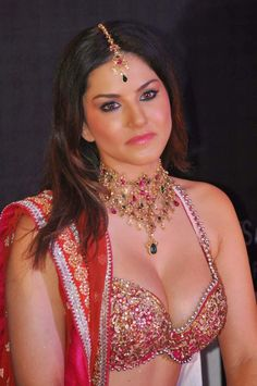 Actress & Model Sunny Leone's in Deep Low Cut Neck Gagra Choli Pictures Gallery. Sunny Leone act in Indian Bollywood Films, Tamil, Telugu, Kannada, Hollywood Movie and Pornographic Cinemas.
