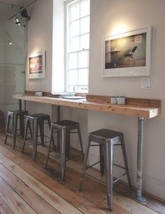 This bar is a simple way to create more seating in a small space. This links to12 Coffee shop interior designs from around the world