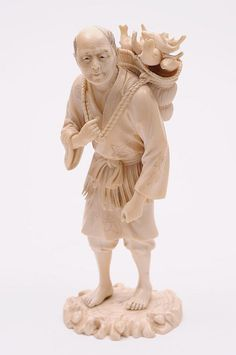 A Japanese carved ivory okimono of a fisherman: returning with a basket of fish on his back, signed, Meiji period, 19cm. high.