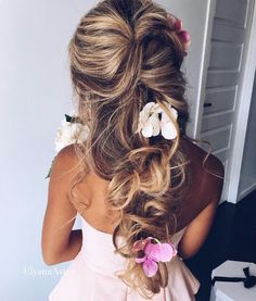 Pretty girly summer hairstyle with flowers