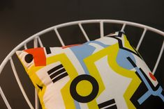 Try bold prints on cushions for a dash of colour in your living area.