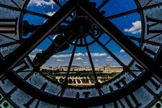 Orsay Museum, Paris, France — by Vincent Ramundo. On the 5th floor in the impressionist wing you can look out of the old clocks. Reminds me of the movie hugo