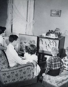 1960 Black and white photograph of family tv time.