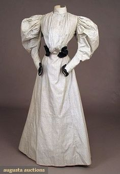 Day Dress 1895, American, Made of cotton. From the 1890's on leg O'mutton sleeves were the latest trend. The gored skirts continued to be in vogue and other than the sleeves,the line of the dresses were simple.: