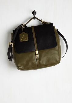 Systematically Stylish Bag. Fellow commuters can tell from one glance at your leather satchel that youre an organized gal. #green #modcloth