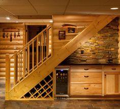 Wine Storage under Stairs looks pretty useful.  Reds in open storage, whites in cool storage.