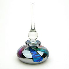 "Dichroic Perfume/Scent Art-Glass Bottle by Sean O'Donoghue has a stunning mirror finish that complements the strips of dichroic glass w' plenty of reflections & sparkle! It measures 5.50"" H x 3"" Dia - avail 'Light Opera Gallery'✽❤❦❤✽"