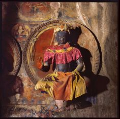 """Amoghasiddhi, the """"Almighty"""" Tathagata, presides over the north of the Circle of Crystalline Truth, his hand gesture signifying fearlessness, protection, peace and belevolence. Inside the Hidden Temple by David Shulman   The Gallery   The New York Review of Books"""
