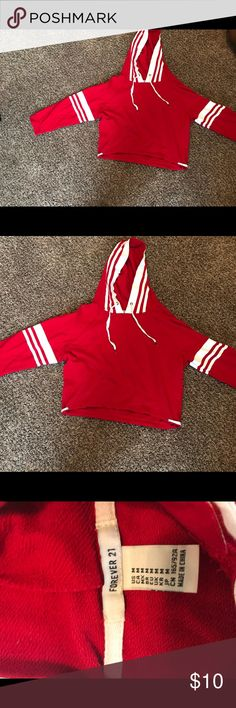 Crop hoodie! Very cute Red cropped hoodie with white detailing. String detailing on bottom corners. Worn twice Forever 21 Sweaters