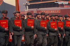 Army soldier paraded with big replica of Chinaman Mao's books.   Red Books - Chairman Mao's Quotations.