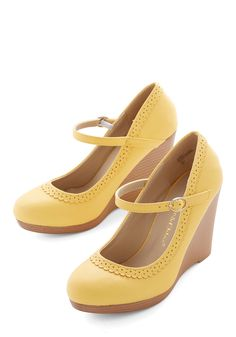 Bon Anniversaire Wedge in Lemon. Your birthday celebration deserves the perfect ensemble to kick off a new year, and these lemon-yellow Mary Jane wedges are the obvious choice! #yellow #wedding #modcloth