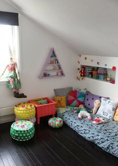 Nice corner in a kids room with loads of cushions and pouffes. Via the boo and the boy: eclectic kids' rooms