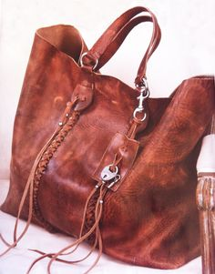 Ralph Lauren Laced Leather tote from S/S 2011 retailed for $2000. This is one of my favorites, maybe THE favorite.