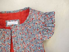 Cute butterfly sleeves. Love the lining and Liberty fabric.