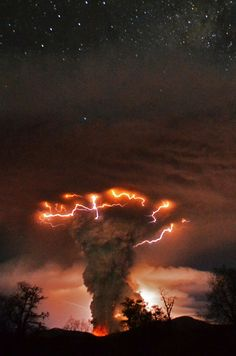A cloud of lightning-topped ash rises toward a starry sky during the June 2011 eruption of southern Chile's Puyehue-Cordón Caulle volcano.