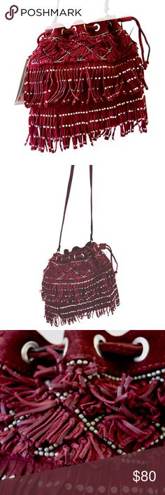 Zara Fringe Bucket NWT bag host pick! NWT Zara festival burgundy bag with fringe, bead embroidery, and studded details. Slightly more purple in person. Outer shell: 40% cow leather, 35% sheep leather, 25% polyester. 24 x 24 x 24 cm. Small pocket inside. Zara Bags Mini Bags