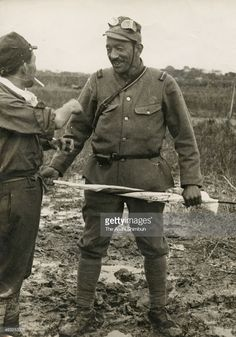 Imperial Japanese Army corporal Yasujiro Ozu smiles as he receives a flag with signatures of his fellow actors, during the Battle of Shanghai on October 1937 in Shanghai, China. Yasujiro Ozu, Meiji Restoration, Imperial Army, Go To Japan, Japanese Film, Army & Navy, Film Director, Screenwriting, Armed Forces