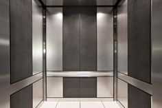 LEVELe-105 Elevator Interior with main panels in Stainless Steel with Sandstone finish; accent panels in Bonded Nickel Silver with Dark Patina and Charleston pattern; Satin Stainless Steel Round Handrails at the Waterfront Pearl, Portland, Oregon