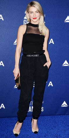 At Delta's pre-Grammys event, Julianne Hough proved that an all-black ensemble is never boring. She paired a sheer sleeveless crop top with high-waisted pants and added subtle pops of color with a metallic box clutch and two-toned Isabel Marant pumps.