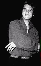 """Résultat de recherche d'images pour """"Elvis Presley's Graceland, in 1965, and playing a little bass guitar."""""""