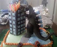 Godzilla birthday cake- good for superheroes party. Would love to see it with the candles lit! Godzilla Party, Godzilla Birthday Party, Godzilla Godzilla, Godzilla Comics, 8th Birthday, Birthday Parties, Birthday Ideas, Birthday Cake, Theme Parties