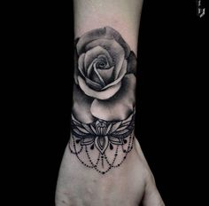 Blackwork rose tattoo on wrist by Benji