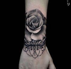 Blackwork rose tattoo on wrist by Benji Unique Tattoos For Women, Rose Tattoos For Women, Trendy Tattoos, Popular Tattoos, Tattoos For Guys, Wrist Tattoos Family, Simple Wrist Tattoos, Rose Tattoos On Wrist, Flower Tattoos
