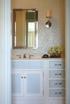 Glamorous bathroom with pearl glass tiles backsplash