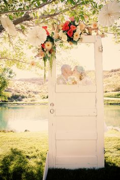 Love the idea of using the door. So many DIY ideas in this sweet wedding. :)