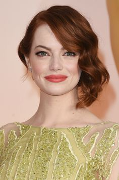 The redheaded beauty looked totally ravishing in her chartreuse hand-beaded Elie Saab dress, which was complimented beautifully by her rosy fresh makeup and a low, side chignon with soft waves.