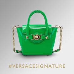 Add a vivid touch of color to your look with this patent #VersaceSignature bag. Discover them all on versace.com