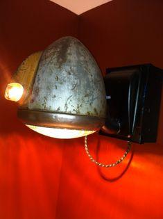 Repurposed Truck Headlight.  Now a bathroom mirror light/fixture.