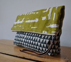 different fabric on either side. cute idea for a summer shoulder bag.