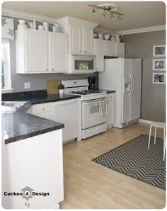 Kitchen Remodel With White Appliances kitchen white cabinets dark countertops photo kitchens white kitchen designs with white appliances Kitchen Renovation Reveal Islands White Cabinets And Pot Racks
