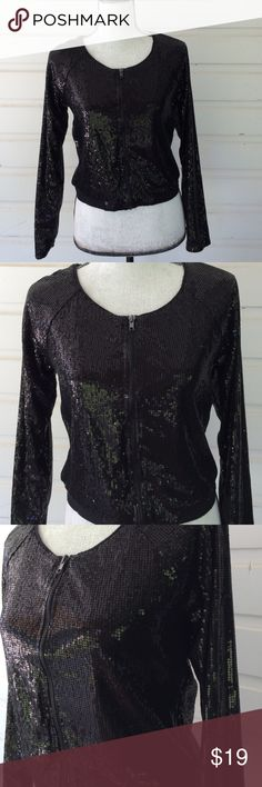 """Black Sequined Cropped Jacket All over sequined jacket with zip front. Two small cotton flat elastic bands at natural waist enhance curves. So on trend but without the expense. Excellent condition, underarm interior shows pilling. 14"""" from underarm to underarm, 18"""" from shoulder to hem.   Always receiving offers with a smile. Nollie Jackets & Coats"""