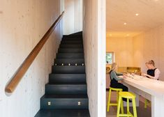A black wooden staircase that leads to the first floor is concealed behind a wall and features treads that double as storage units. Helsinki, Wooden Staircases, Timber Cladding, Balcony Railing, Timber House, Wood Detail, Apartment Interior, Solar Panels, Building A House